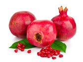 Ripe pomegranates with leaves isolated — Stock Photo