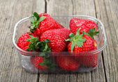 Plastic tray with strawberries — Stock Photo