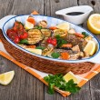 Seabass fish baked with vegetables, herbs and lemon — Stock Photo