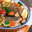 Seabass fish baked with vegetables, close-up — Stock Photo
