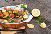 Fresh seabass baked with vegetables — Stock Photo
