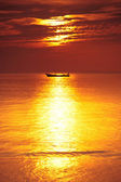 Boat on sea at sunset — Stock Photo