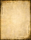 Old parchment paper texture with ornate design — Stock Photo