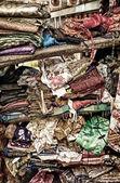 Rough stacking of clothing on shelf — Stock Photo