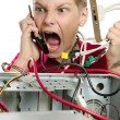 Stock Photo: Repair your computer. young mcalls to technical support.