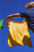 Hands hanging clothes. — Stock Photo
