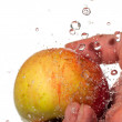 Apple, hand and water. — Foto de Stock