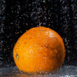 Orange and water. — Stock Photo