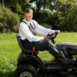 Man and mower. - Stock Photo