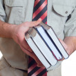 Man holding books. — Stock Photo
