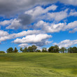 Field and clouds. — Stock Photo