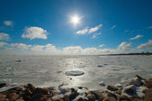 Sunshine over frozen Baltic sea. — Zdjęcie stockowe