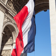 French flag in Paris Triumphal arch. — Stock fotografie