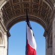 French flag in Paris Triumphal arch. — Stock Photo