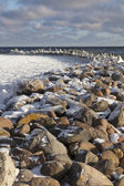 Old breakwater in winter. — Stock Photo