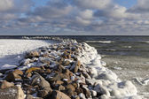 Old breakwater in winter. — Stockfoto