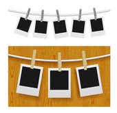 Photo frames with pins on rope — Stock Vector