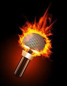 Micrófono en fuego — Vector de stock
