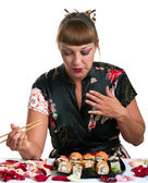 Woman eating rolls — Stock Photo