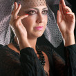 Girl in a black veil — Stock Photo