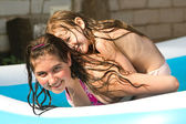 Kids in a swimming pool — Stock Photo
