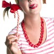 Girl with striped candy — Stock Photo