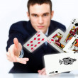 Young man showing poker cards — Stock Photo #12291349
