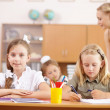 Little girl at school class — Stock Photo #12436315