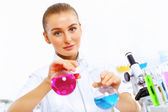 Young female scientist working in laboratory — Стоковое фото