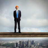 Businessman standing on the construction site — Foto de Stock