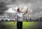 Geschäftsperson mit digitalen symbolen — Stockfoto