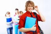 Estudiante de camisa roja con libros — Foto de Stock