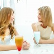 Young woman with a glass of drink — Stock Photo