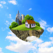 A piece of land in the air with house and tree. - Stock Photo