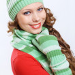 Young woman wearing winter hat and warm scarf - Stock Photo
