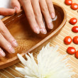 Woman is getting manicure — Stock Photo