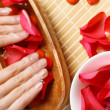Woman is getting manicure — Stock Photo #12782823