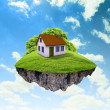 A piece of land in the air with house and tree. — Stockfoto