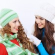 Young woman wearing winter hat and warm scarf — Stock Photo