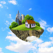 A piece of land in the air with house and tree. — 图库照片