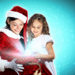 Little girl with christmas gifts and santa — Stock Photo #13350586