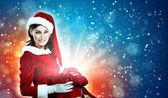 Beautiful girl in santa costume — Stock Photo
