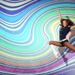 Stock Photo: Young woman dancing and jumping...