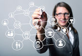 Businesswoman pressing social media icon — Stock Photo