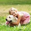 Little girl with her dog — Stock Photo #13468079