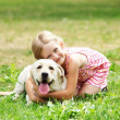 Little girl with her dog — Stock Photo #13468099