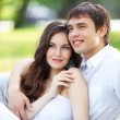 Young love Couple smiling under blue sky — Stockfoto