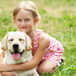 Little girl with her dog — Stock Photo #13468747