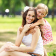 Mother and daughter in the park — Stock Photo #13469078