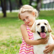 Little girl with her dog — Stock Photo #13469140